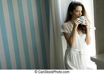 Woman with coffee mug