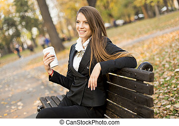 Woman with coffee outdoor