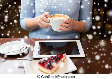 woman with coffee, tablet pc and cake