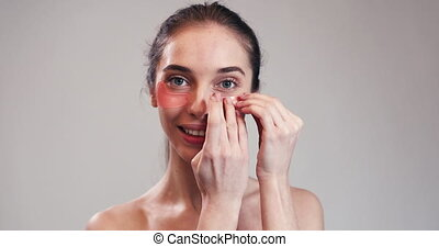Woman with Collagen Pads under Her Eyes - Woman with red...