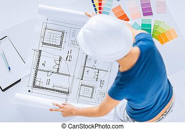 woman with color samples and blueprint - architecture,...