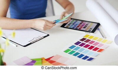 woman with color samples for selection - woman working with...