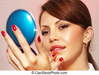 woman with compact mirror l