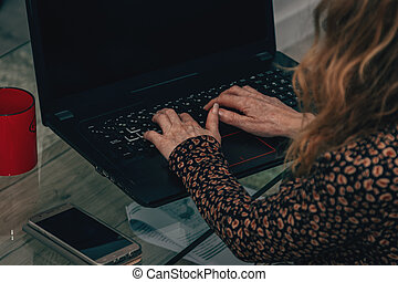 woman with computer at home working
