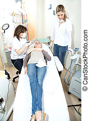 woman with cosmetic dental team