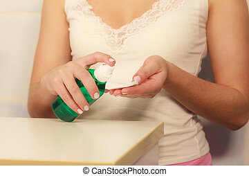 Woman with cotton swab cleaning her skin. - Make up remove ...