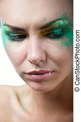Woman with creative green makeup