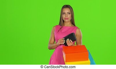 Woman with credit card and shopping bags. Green screen
