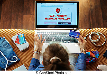 woman with credit card having bad online shopping on laptop