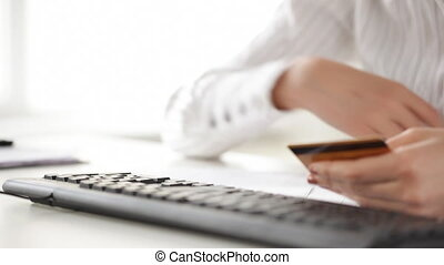 woman with credit card making internet shopping - woman with...