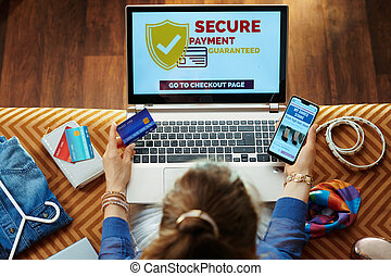 woman with credit card making safe online purchases on website