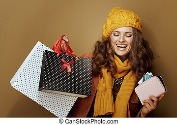 woman with credit card purse and shopping bags isolated on beige