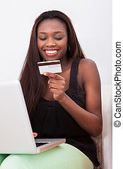 Woman With Credit Card Shopping Online At Home