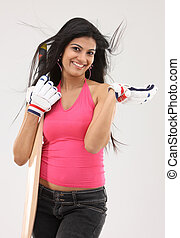 woman with cricket bat & gloves