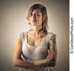Woman with crossed arms - Tattooed woman with crossed arms