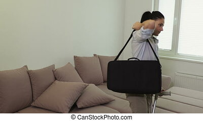 Woman With Crutches taking bag on the couch