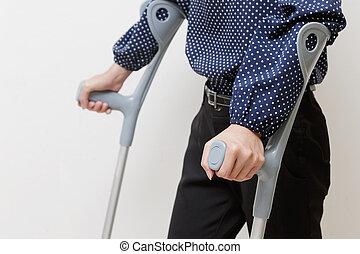 Woman with crutches ,walk rehabilitation