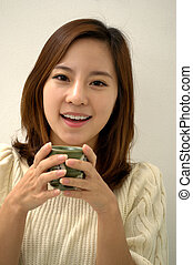 woman with cup of coffee or tea