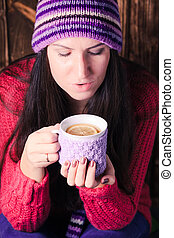 Woman with cup of tea