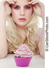 woman with cupcake looks beauty