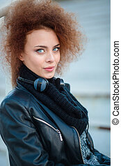 Woman with curly hair looking at camera