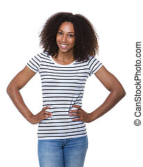 Woman with curly hair smiling with hands on hip