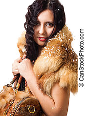 Woman with curly hair stand with leather bag with snow on...