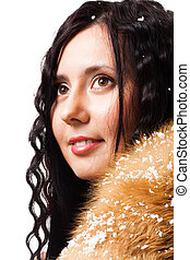 Woman with curly hair with fur and snow on it, isolated