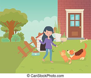 woman with cute little cat and dog in the house garden