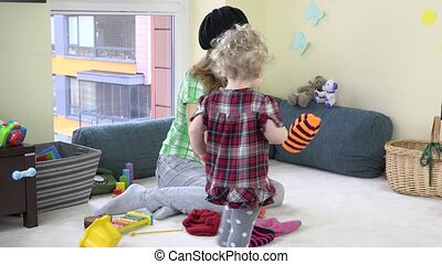 woman with cute toddler girl measure colorful knitted hat...