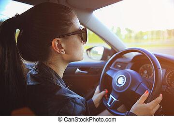 Woman with dark hair in car