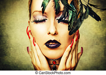 Woman with dark makeup and red nails