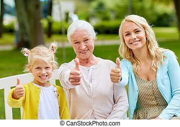 woman with daughter and senior mother at park