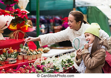 Woman with daughter in market
