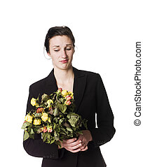 Woman with dead flowers