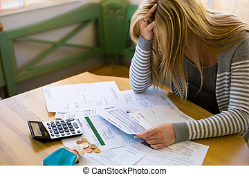 woman with debts and bills - a woman with unpaid bills has ...