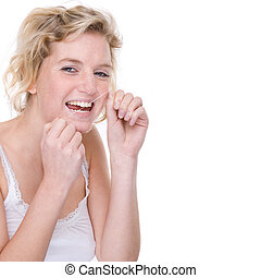Woman with dental floss - Full isolated portrait of a...