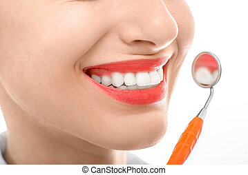 Woman with dental mirror on white background