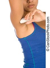 Woman with deodorant stick - Woman applying deodorant in...