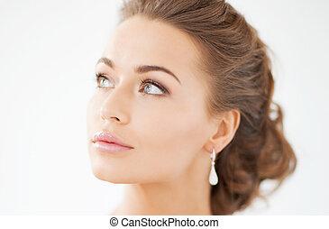 woman with diamond earrings - beautiful woman in white dress...