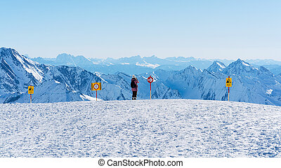 Woman with digital camera taking photos in Hintertux Glacier Austria