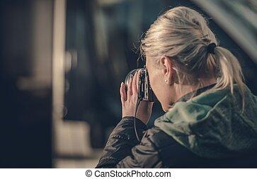 Woman with Digital Camera