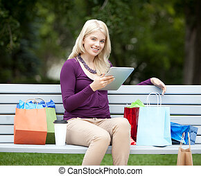 Woman with Digital Tablet in Park