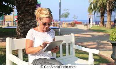 woman with digital tablet outdoor