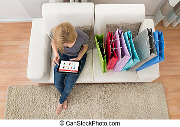 Woman With Digital Tablet Shopping Online