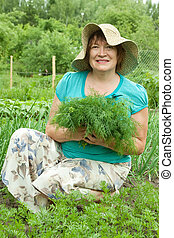 woman with dill in garden