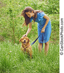 Woman with dog Labrador