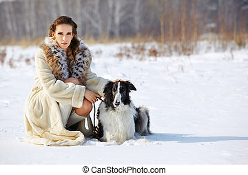 woman with dog outdoors - outdoor portrait of beautiful...