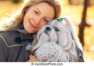 Woman with dog - Young woman with favorite dog.