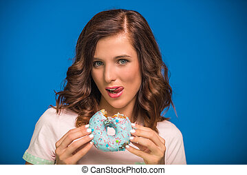 Woman with donut.